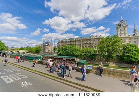 Tourists visiting Ile de la Cite island in Paris, France