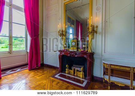 Elegant interiors in Le Petit Trianon palace, Versailles, Paris, France