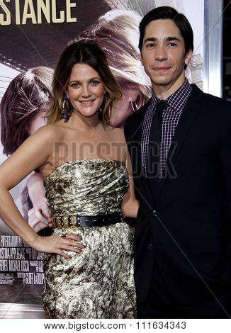 HOLLYWOOD, CALIFORNIA - August 23, 2010. Drew Barrymore and Justin Long at the Los Angeles premiere of