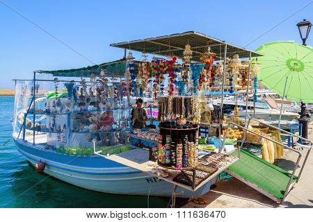 Souvenir shop, organised on fishing boat at port of Chania town