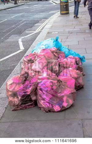 Pink And Blue Garbage Bags On The Street