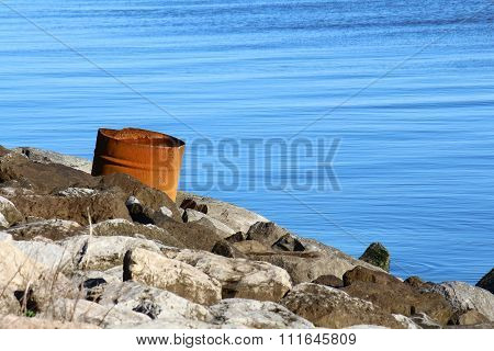 Rusty barrel by the water