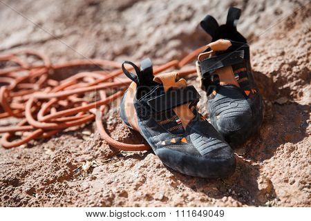 Rock climbing shoes over belay rope closeup