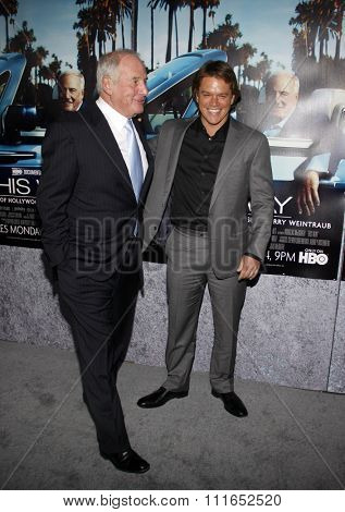HOLLYWOOD, CALIFORNIA - March 22, 2011. Matt Damon and Jerry Weintraub at the Los Angeles premiere of