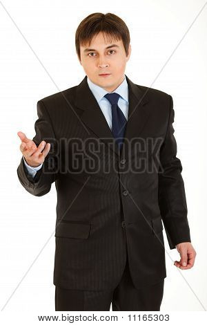 Confident young businessman looking at camera isolated on white