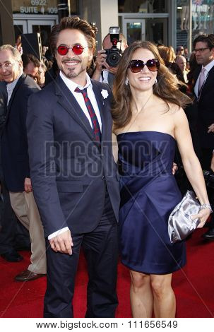 HOLLYWOOD, CALIFORNIA - April 26, 2010. Robert Downey Jr. and Susan Downey at the World premiere of