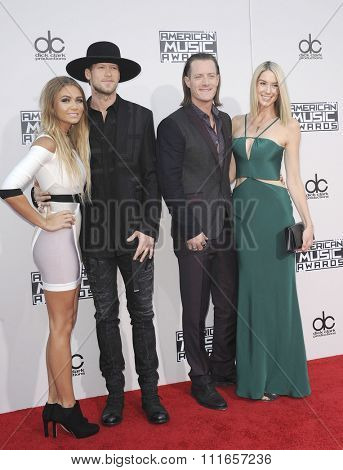 Brian Kelley and Tyler Hubbard of Florida Georgia Line, and Hayley Stommel at the 2015 American Music Awards held at the Microsoft Theater in Los Angeles, USA on November 22, 2015.