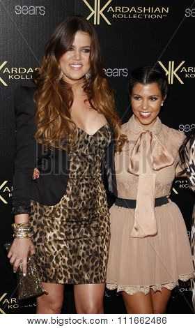 Khloe Kardashian and Kourtney Kardashian at the Kardashian Kollection Launch Party held at the Colony in Los Angeles, California, United States on August 17, 2011.
