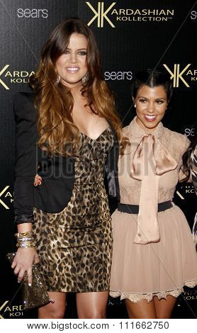 Khloe Kardashian and Kourtney Kardashian at the Kardashian Kollection Launch Party held at the Colony in Hollywood, USA on August 17, 2011.