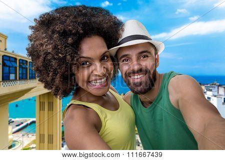 Brazilian couple taking a selfie photo in Bahia, Brazil