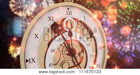 Close-up of antique pocket clock with roman numbers against colourful fireworks exploding on black background Close-up of antique pocket clock with roman numbers against white vackground