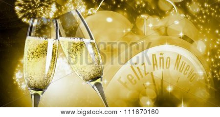 Champagne glasses clinking against white fireworks exploding on black background