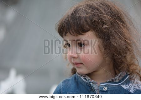 Young girl with tear running down cheek