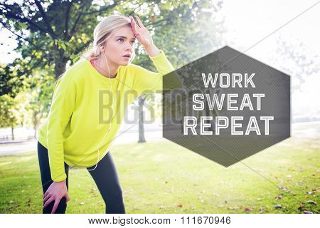 Active exhausted blonde pausing after running against motivational new years message