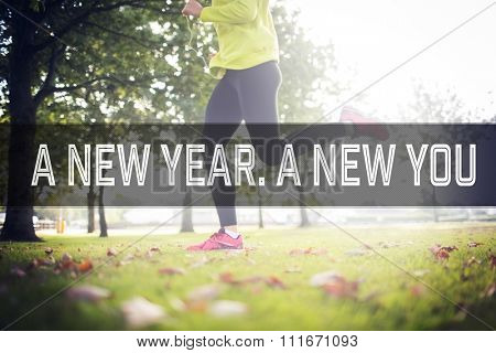 Active woman jogging against motivational new years message