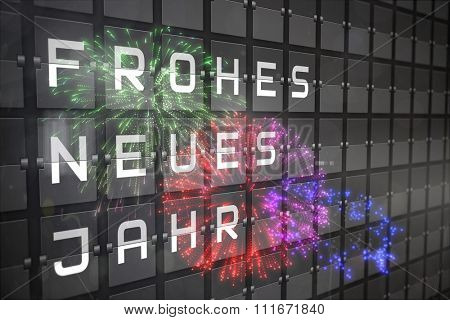 Colourful fireworks exploding on black background against new year message on black roller board in german