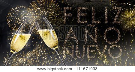 Champagne glasses clinking against glittering feliz ano nuevo