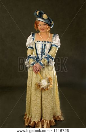 Girl In Polish Clothes Of 16 Century With Mirror-Fan