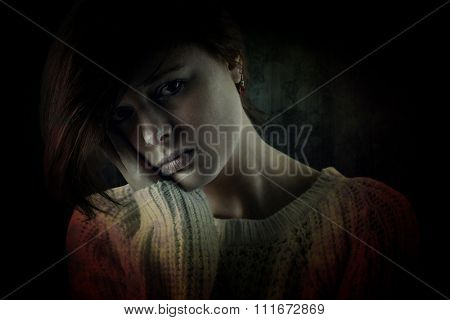 Pretty brunette feeling sad against dark background