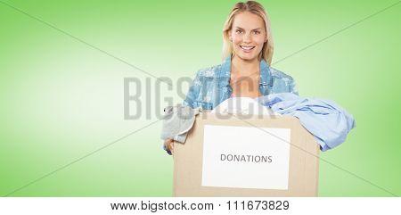Portrait of cheerful woman volunteer against green vignette