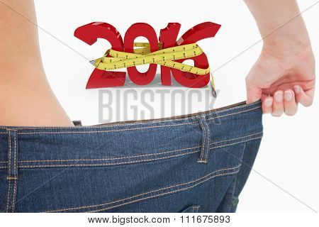 Close up of a woman waist in a too big pants against white background with vignette