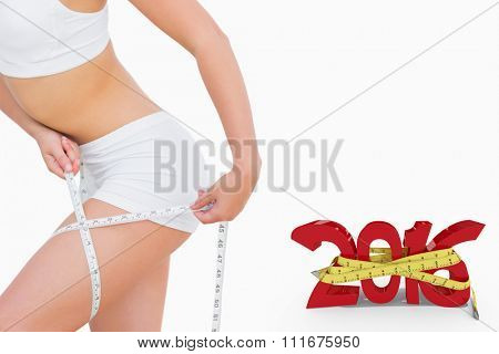 Slim woman measuring thigh with tape measure against white background with vignette