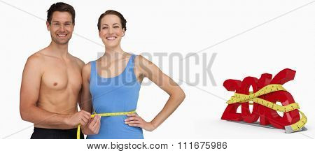 Fit young man measuring womans waist against white background with vignette