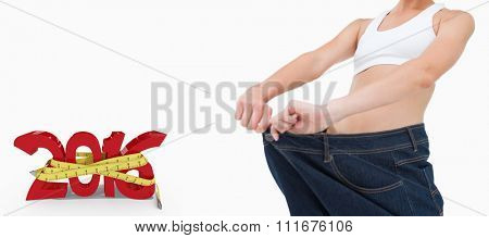 Brunette in a jeans too big against white background with vignette