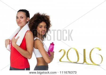 Fit women standing with waterbottle and towel against white background with vignette