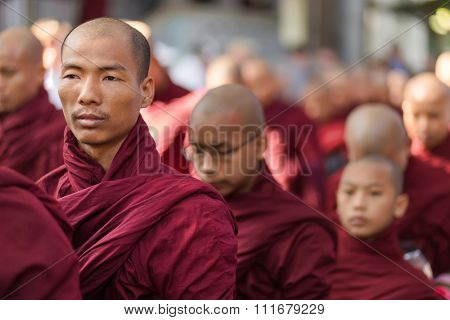 AMARAPURA, MYANMAR, JANUARY 20, 2015 : Buddhist monks are queuing to collect the unique daily meal at noon in the Mahagandayon monastery near Mandalay, Myanmar (Burma).