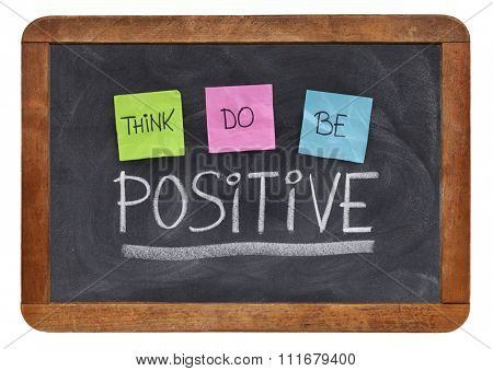 think, do, be positive - positivity concept, color sticky notes, white chalk and handwriting on a vintage slate blackboard