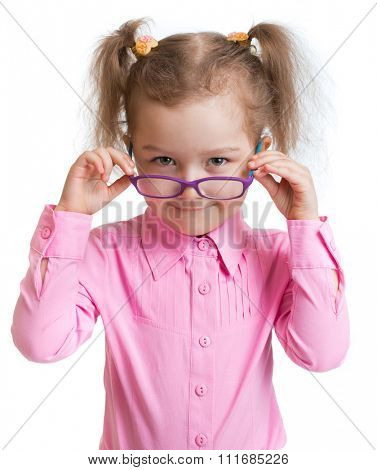 Funny kid putting on spectacles isolated