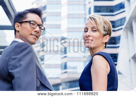 Business team members standing next to each other in business district