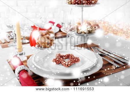 Beautiful Christmas table setting over snow effect