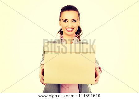 Sad businesswoman carrying box after loosing job.