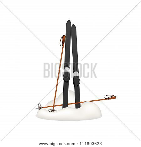 Old wooden skis and old ski poles standing in snow
