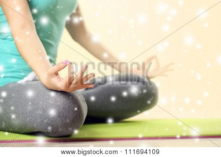 Hand yoga gesture on bright background over snow effect