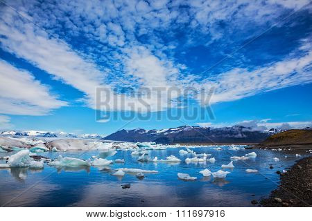 Beautiful summer morning in the ocean bay with ice floes. Ice lagoon in Iceland