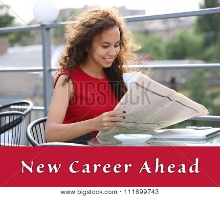 Dream job concept. Portrait of young pretty woman reading newspaper at summer terrace