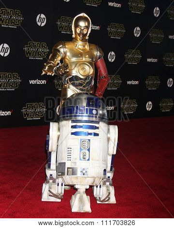 LOS ANGELES - DEC 14:  R2-D2, C-3PO at the Star Wars: The Force Awakens World Premiere at the Hollywood & Highland on December 14, 2015 in Los Angeles, CA