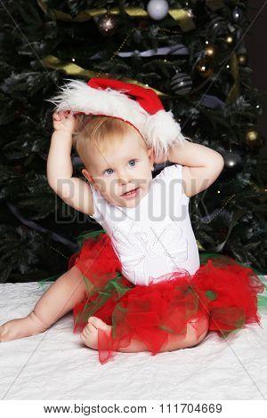 Happy New Year! Little baby near cristmas tree.