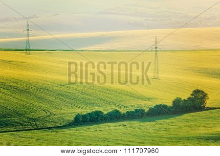 Vintage retro effect filtered hipster style image of Moravian summer rolling landcsape with two power line tower. Moravia, Czech Republic