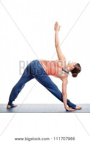 Sporty fit woman practices Ashtanga Vinyasa yoga asana utthita trikonasana - extended triangle pose view from back isolated on white