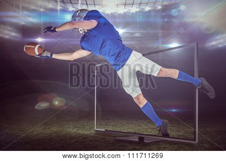 Sports player catching ball against american football arena