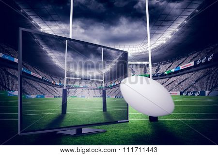 rugby ball against rugby stadium
