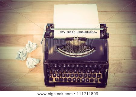 New years resolutions against typewriter with paper on table in office