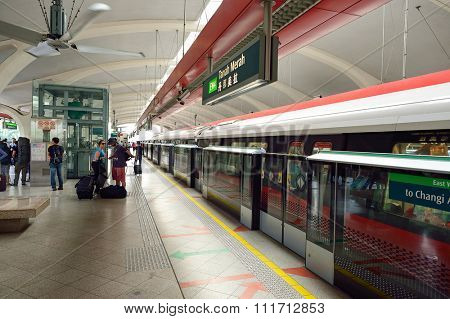 SINGAPORE - NOVEMBER 07, 2015: half-height platform screen doors at MRT station. The Mass Rapid Transit (MRT) is a rapid transit system forming the major component of the railway system in Singapore
