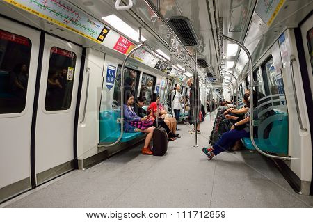 SINGAPORE - NOVEMBER 07, 2015: passengers in MRT train. The Mass Rapid Transit, or MRT, is a rapid transit system forming the major component of the railway system in Singapore