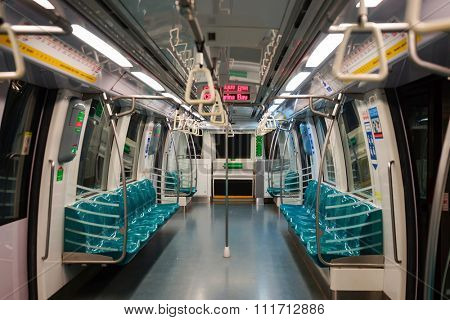 SINGAPORE - NOVEMBER 08, 2015: interior of MRT train. The Mass Rapid Transit, or MRT, is a rapid transit system forming the major component of the railway system in Singapore
