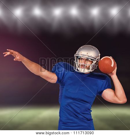 American football player about to throw the ball against rugby pitch